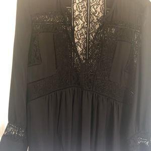 Lace and silk long sleeve blouse.